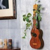 unusual-wall-mounted-bonsai-decor-with-ukulele-vase-in-interior-settings